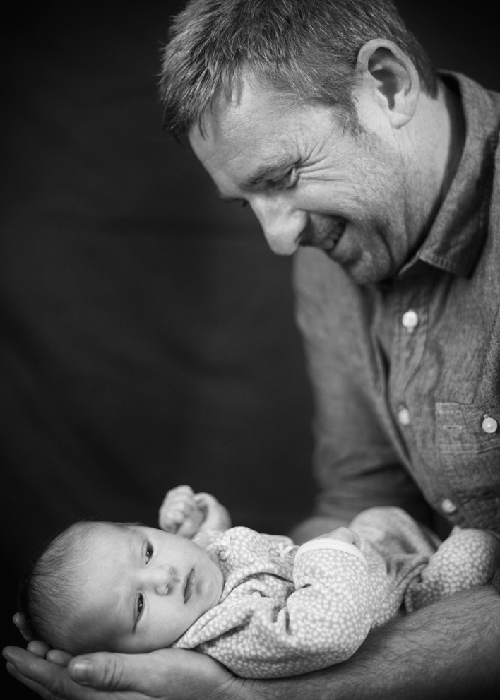 Loving Father and Newborn Daughter